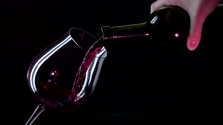 şarap cam : Bottle, glass with red wine, black, closeup, slowmotion Stok Video