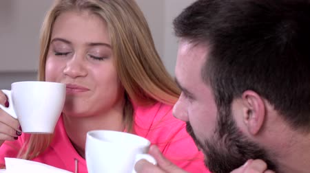 home life : Couple drinking tea or coffee together at home, closeup