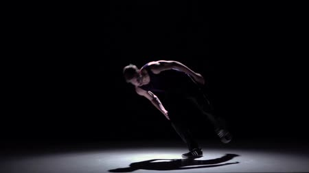 biodro : Stylish and cool breakdance style dancer, on black, shadow, slow motion