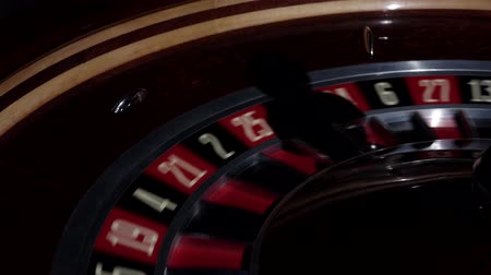 usual : Usual roulette wheel running with fallen white ball, shadow, close up Stock Footage