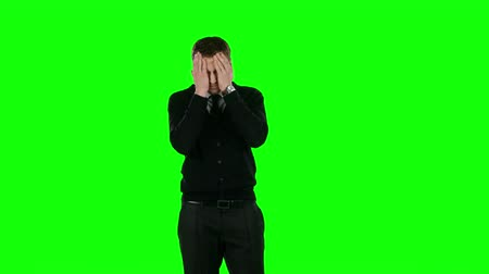 small businessman : Businessman holding his head. Green screen Stock Footage
