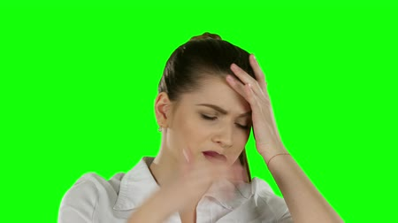 personalidade : Businesswoman has headache. Green screen