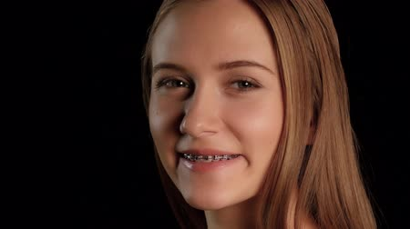 brackets : Girl with braces and blue eyes. Black