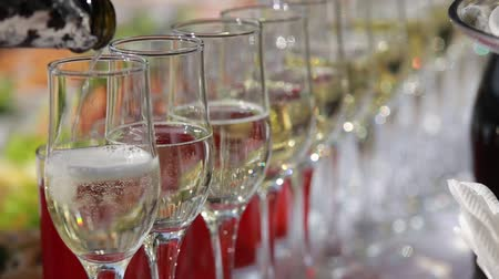 sparkling drink : Pouring Champagne into glasses on the festive table
