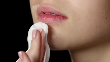 remover : Cleaning skin. Skin around the mouth. Black. Closeup