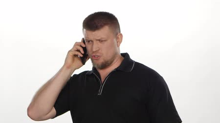 spite : Angry man talking on phone. White