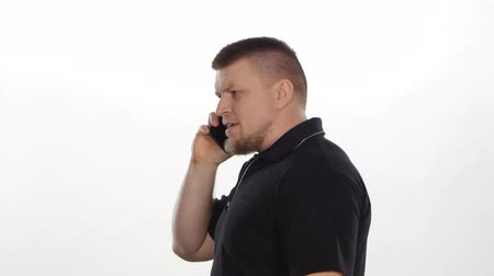 spite : Angry stressed man yelling on a phone call. White