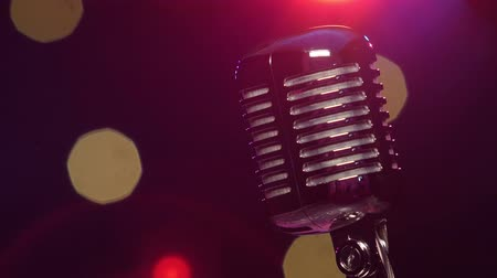 kayıt : Vintage microphone against dark blurry background with bright flashing lights