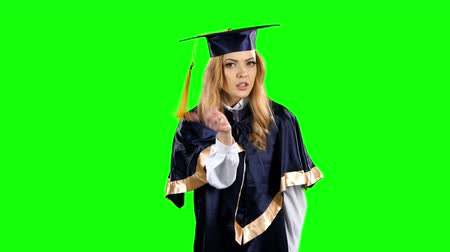 descontente : Graduate threatening finger and shows sign quietly. Green screen