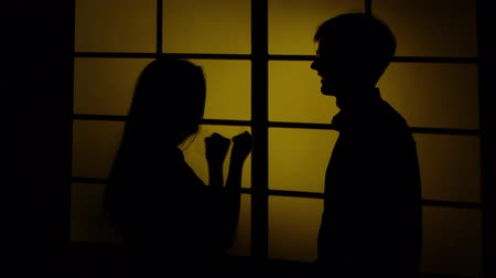 evcil : People and domestic violence. Silhouette. Close up Stok Video