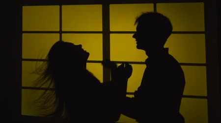 feszült : Strained relationship. Quarrel with a slap. Silhouette. Slow motion. Close up Stock mozgókép