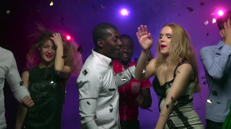 клуб : Dancing girl with African American man at party. Slow motion Стоковые видеозаписи
