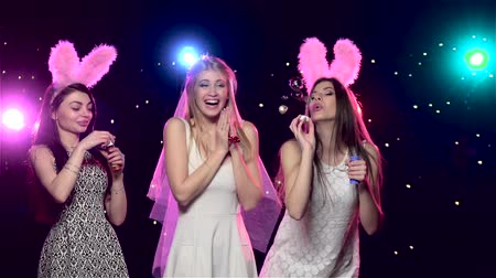 slowing : Happy girls at bachelorette party blowing soap bubbles. Slow motion