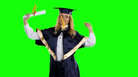 commencement : Graduate celebrates getting a diploma. Green screen
