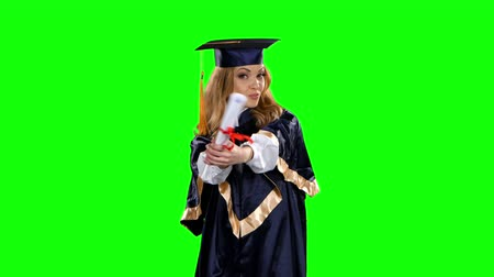 graduação : Dancing graduate. Green screen Stock Footage