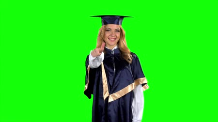 milestone : Graduate girl with a thumbs down. Green screen. Slow motion Stock Footage