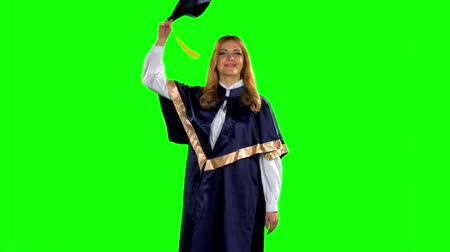 graduação : Graduate throws his cap in the air. Green screen. Slow motion