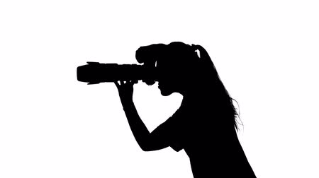 photojournalist : Photographer provides professional photography. White. Silhouette