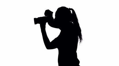 photojournalist : Photographer attaches to the lens and makes photography. White. Silhouette