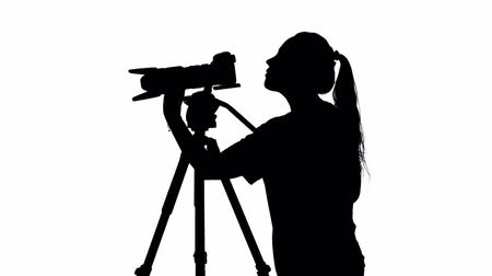 photojournalist : Photographer spends shooting video. White. Silhouette Stock Footage
