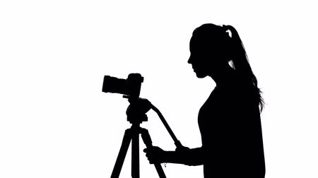 photojournalist : Photographer in the studio. Creative work. White. Silhouette Stock Footage