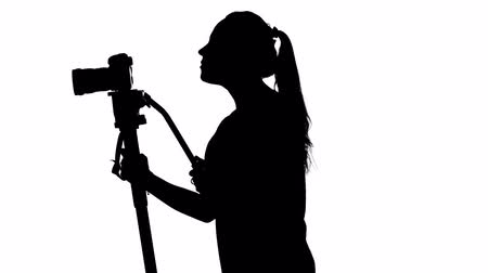 photojournalist : Photographing with a tripod. White. Silhouette Stock Footage