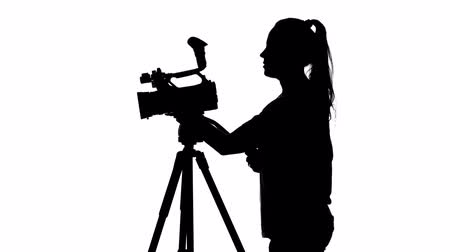 photojournalist : Operator recording digital video. White. Silhouette Stock Footage