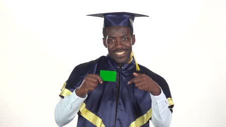 commencement : Graduate holding a green card. White. Slow motion. Close up Stock Footage