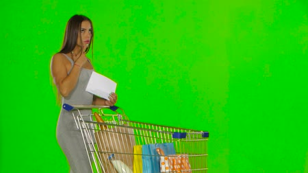 pastry purse : Woman checks the shopping list. Green screen