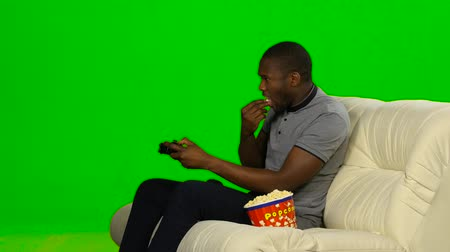 angrily : Man won in the game on the console and happy. Green screen
