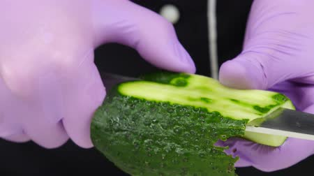 peeler : Chef carves crafts cucumber. Close up Stock Footage