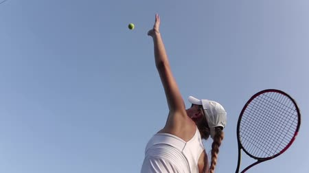 tennis game : Girl serving tennis ball. Tennis player. Slow motion Stock Footage