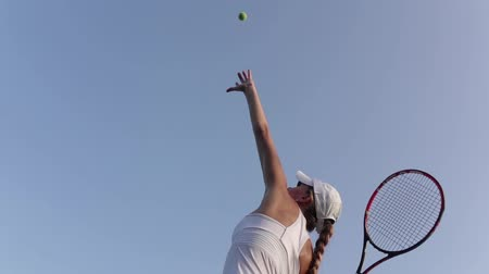 tennis game : Beautiful female tennis player serving outdoor