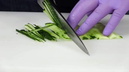 kökenleri : Chef cuts the cucumber. Close up. Slow motion Stok Video