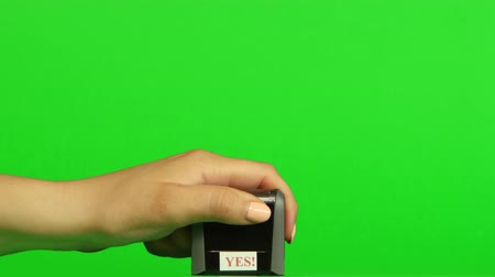 postabélyegző : Stamp yes on a green background. Close up. Green screen