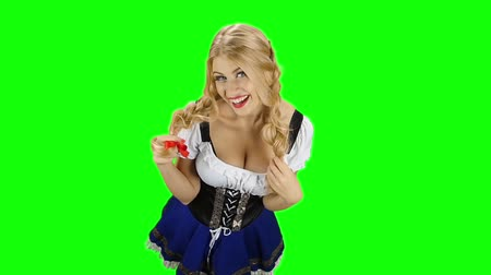 espartilho : Girl in bavarian costume touches her hair and laughs. Green screen. Slow motion Stock Footage