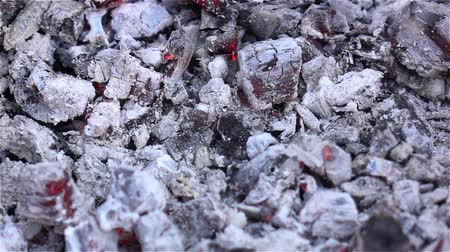 briquette : White ash. Smoldering embers in the fire. Close up