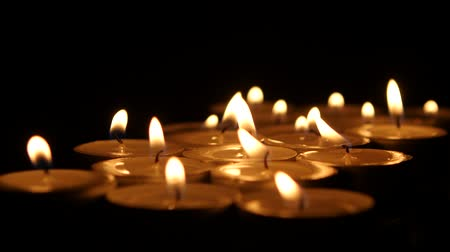 the conception : Tea candles burning in the darkness. Ð¡lose up Stock Footage