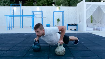 lift ups : Man push-ups on dumbbells