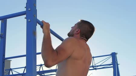 lift ups : Guy push-ups on the horizontal bar. Slow motion Stock Footage
