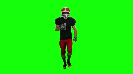 canal : Player is running in a red helmet with the ball in his hands. Front view. Green screen