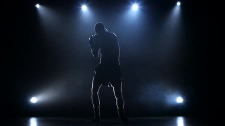 fight club : Boxer develops the right and left hook rear view Stock Footage