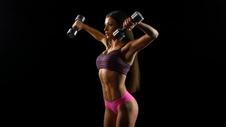 atletika : beautiful strong woman exercises with dumbbells
