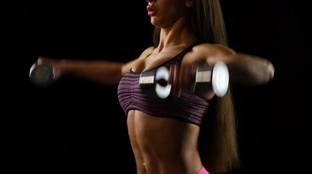 atletismo : Close-up of a young woman exercising with weights in the gym Stock Footage