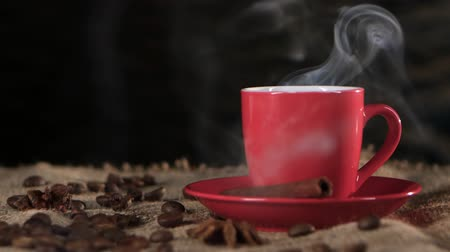 black coffee : Ð¡up of hot coffee spreads a pleasant fragrance in the room. Black background