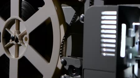 pic : Projector that turns the film reel. Side view