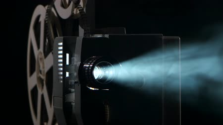 projetor : Close up of a vintage movie projector. Projection rays