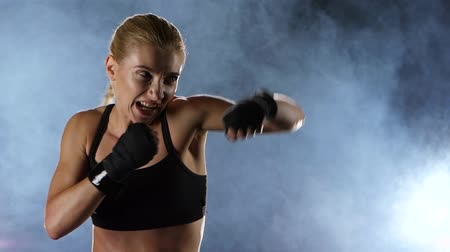 boxe : Slow motion. Training a boxer girl hands hit the target.