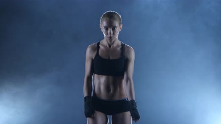 warms : Sportswoman boxer warms up the muscles before the fight Stock Footage