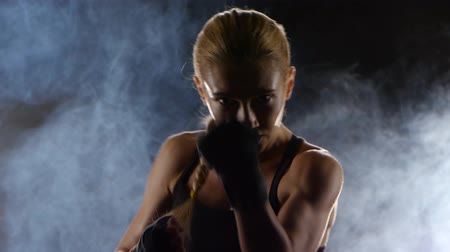 warms : Clear accurate punches towards the camera makes the girl boxer